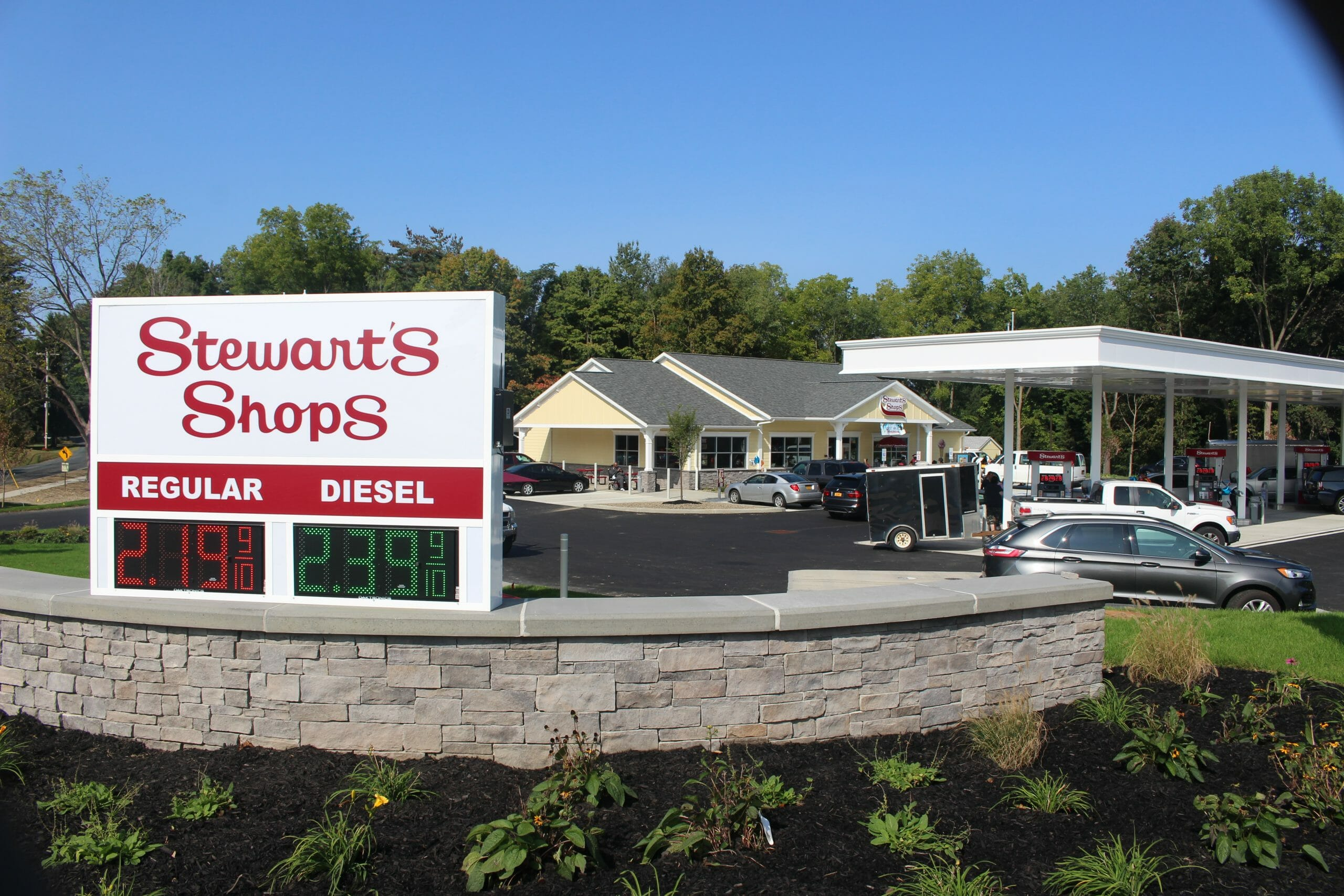 a wide shot of the stewarts shop with gas prices showing