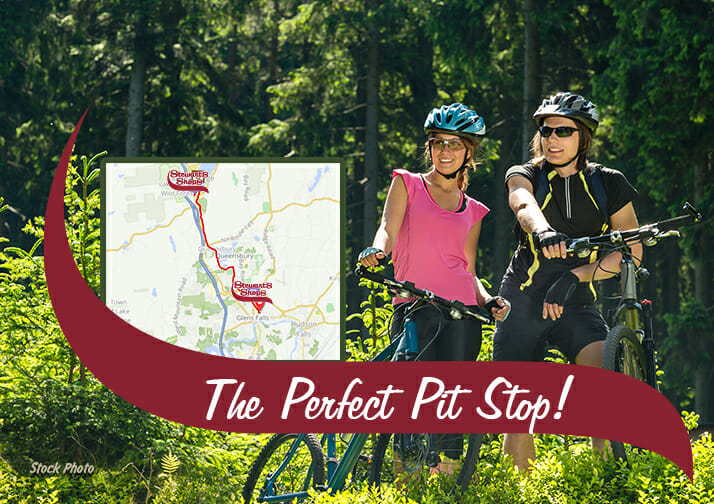 A map with stewarts shops. Two women with bikes. The perfect pit stop.
