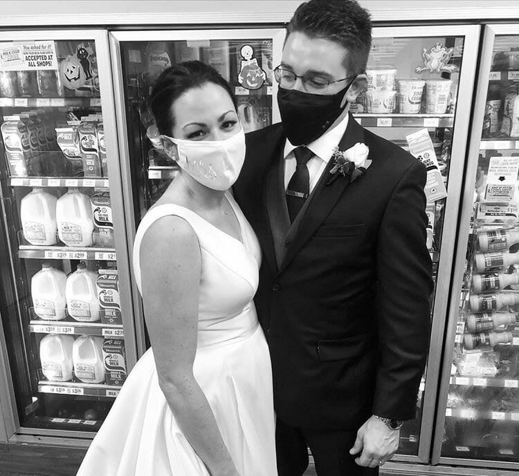 bride and groom in front of cooler in black and white