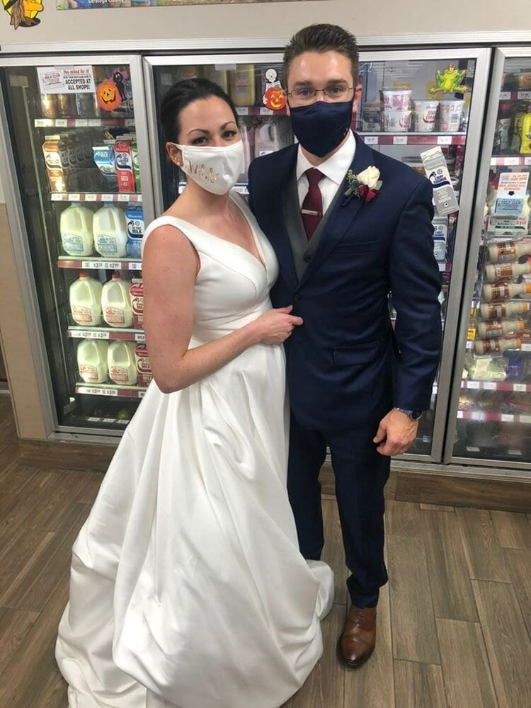 bride and groom in front of cooler