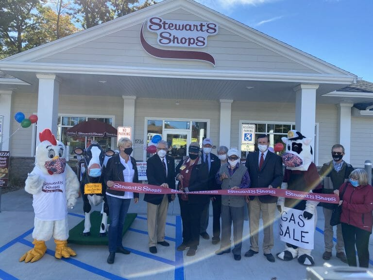 ribbon cutting group in front of shop
