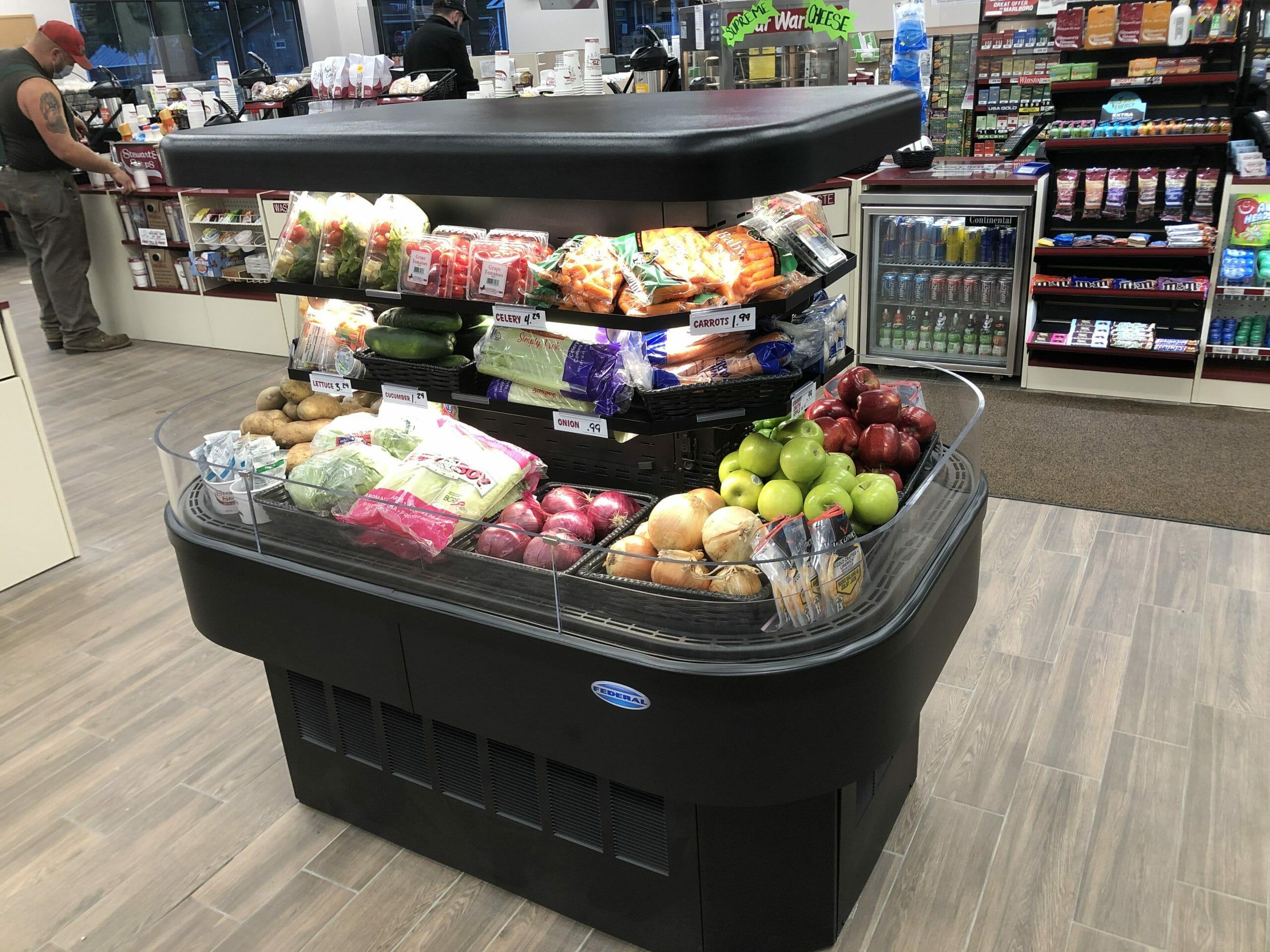Open refrigerator full or fruit and veggies