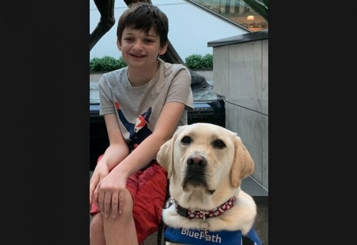 Service dog Clancey with his owner Alex