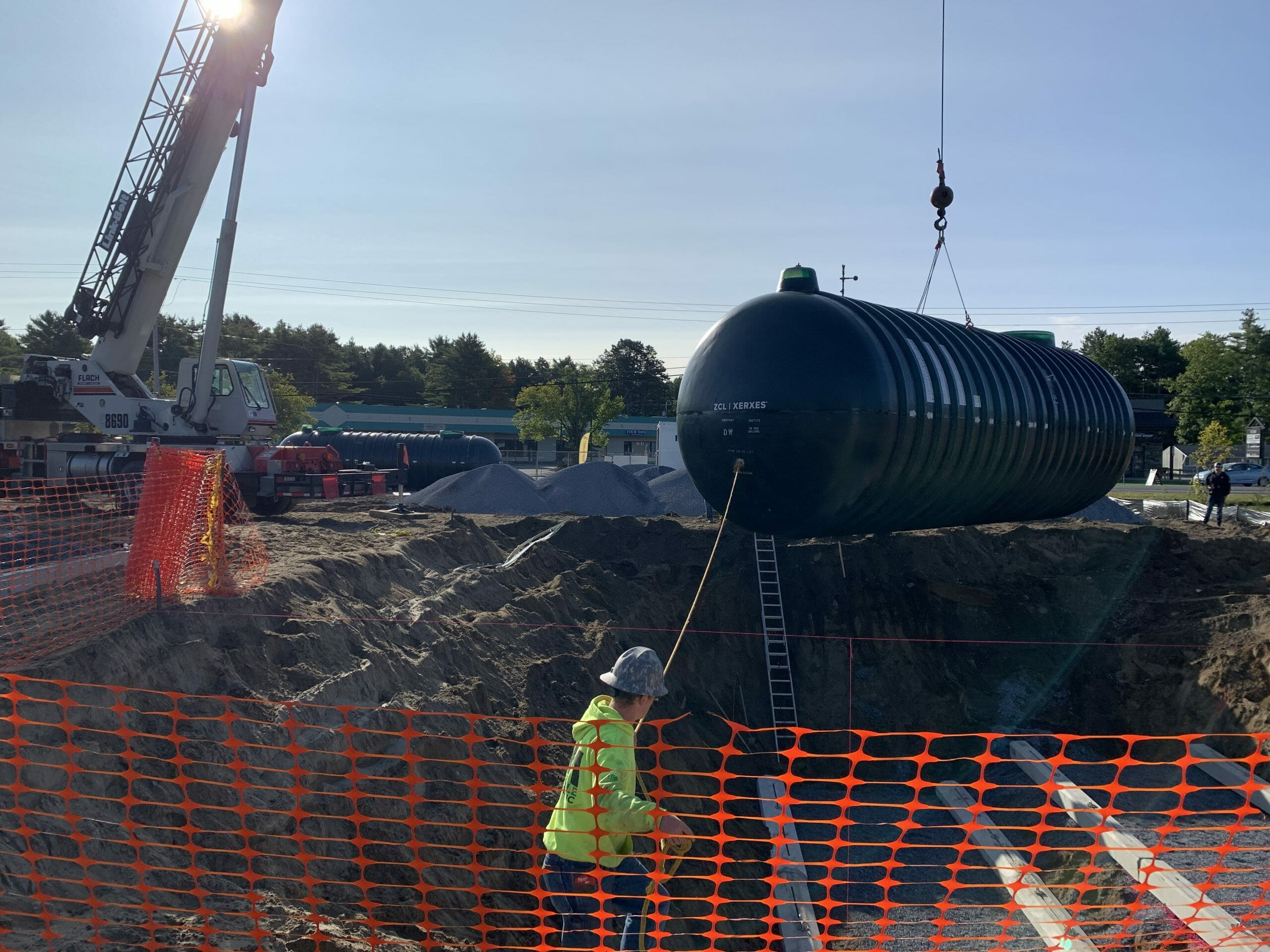 Gas tank being lowered into the ground