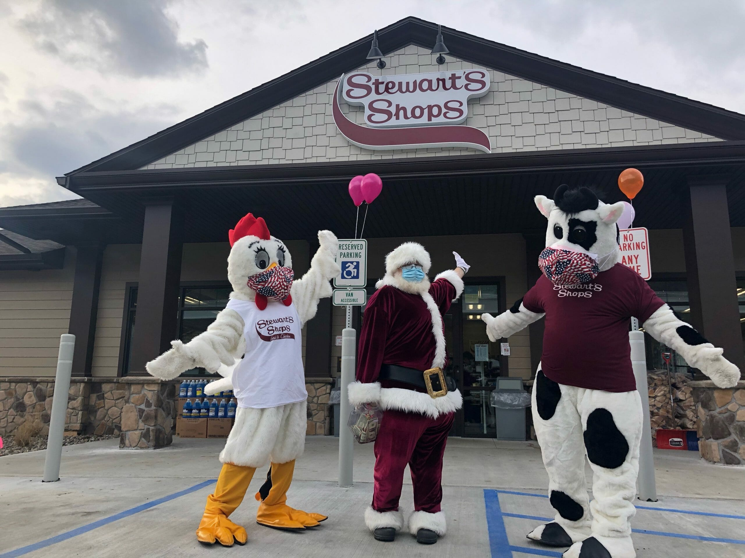Chicken and Cow mascots with Santa