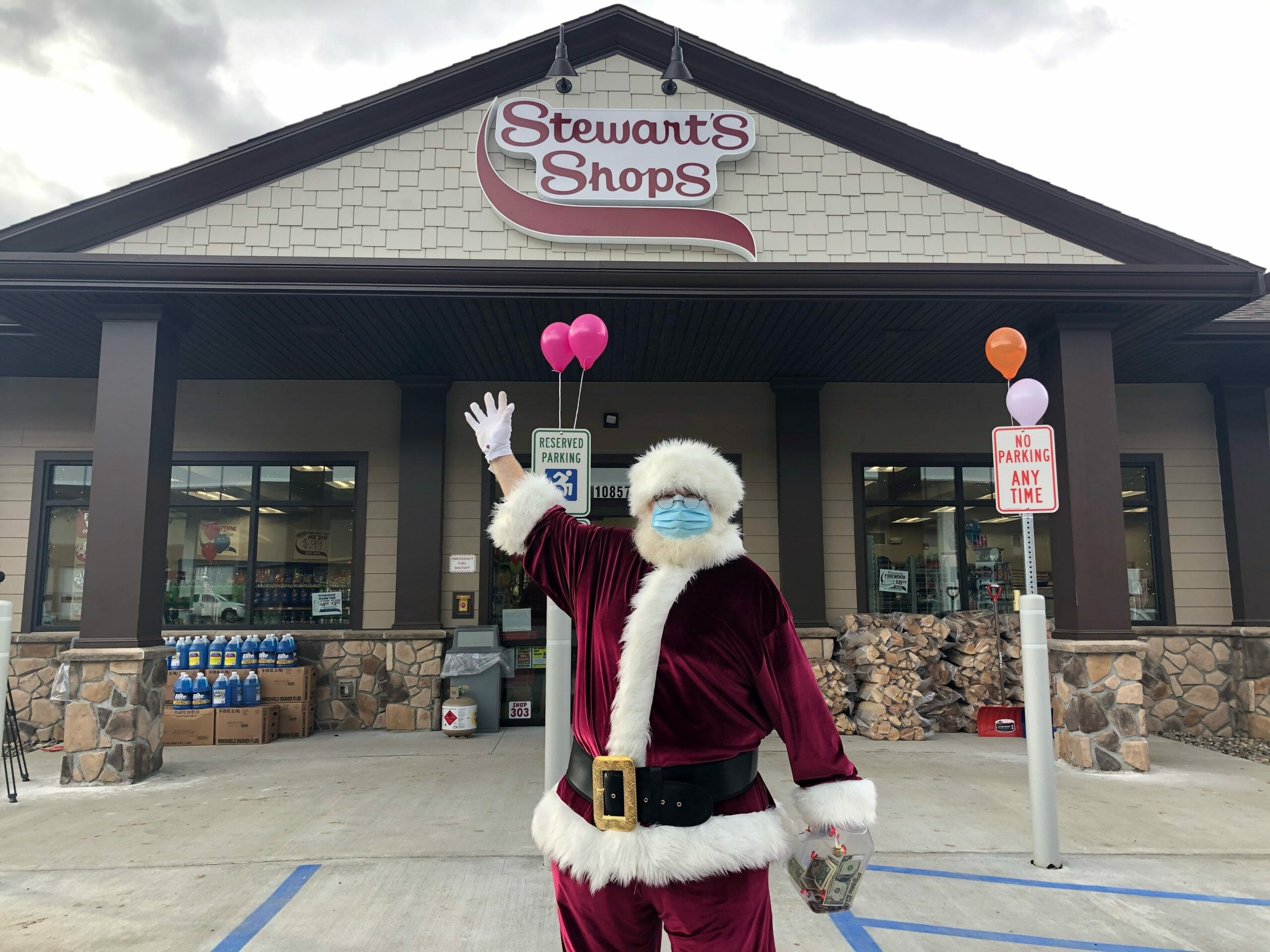 santa standing in front of store