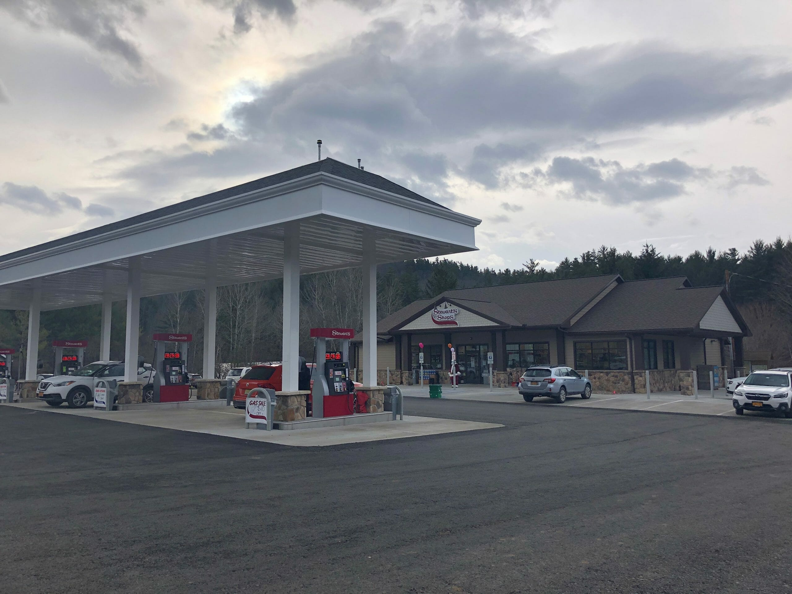 new store exterior with gas pumps