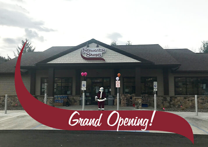 grand opening santa in front of shop