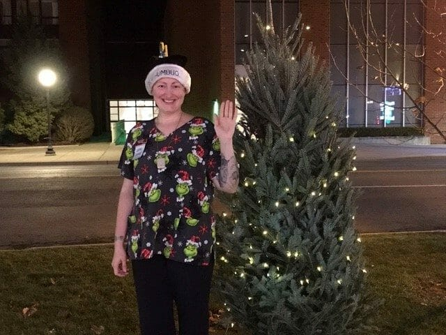 Partner at City Center shop posing with our Christmas tree
