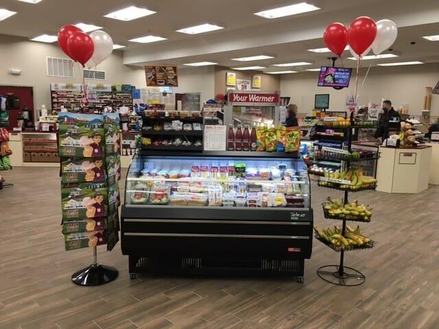 open refrigerator in shop