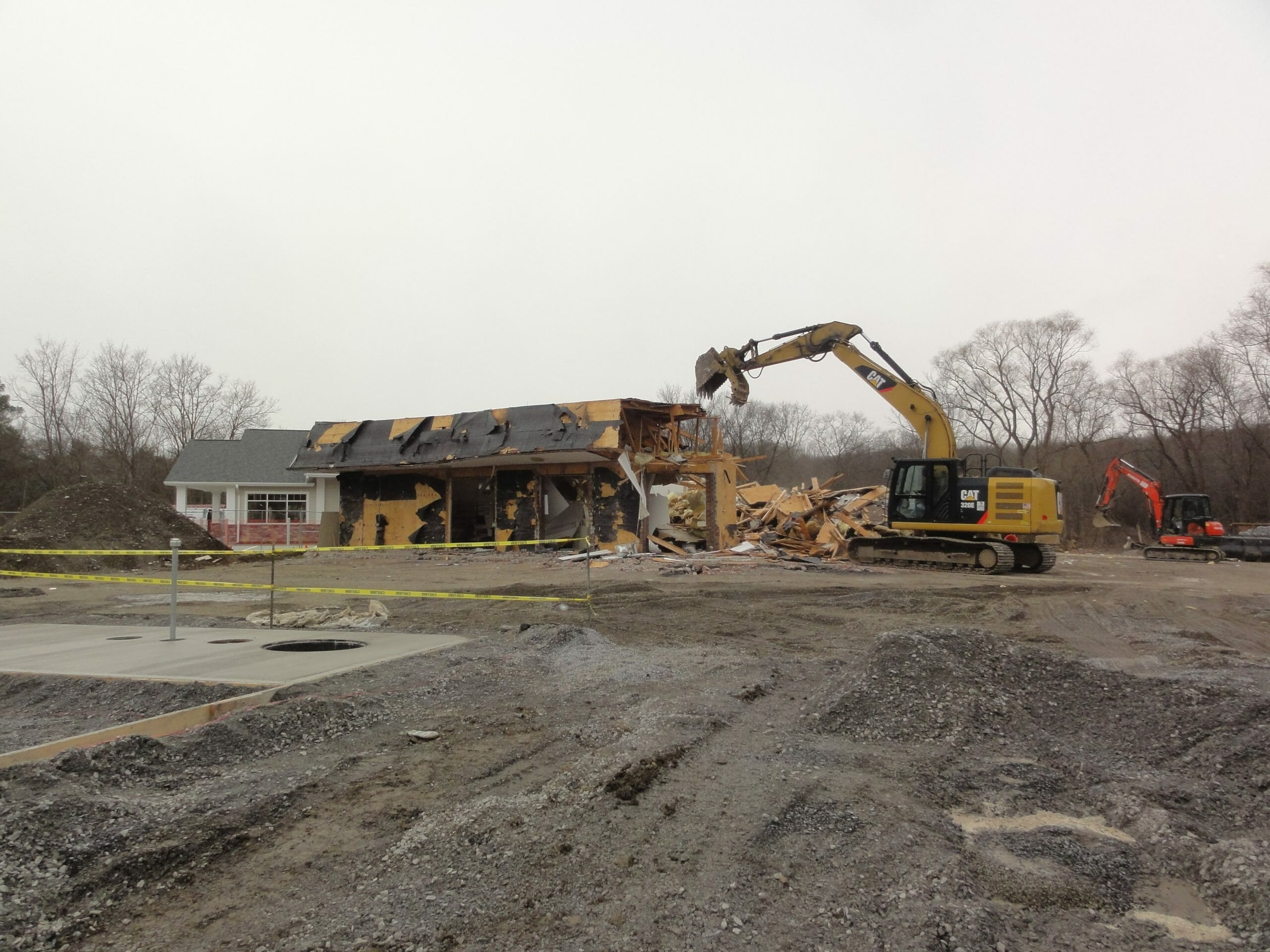 Tearing Down Old Shop with New Shop in background