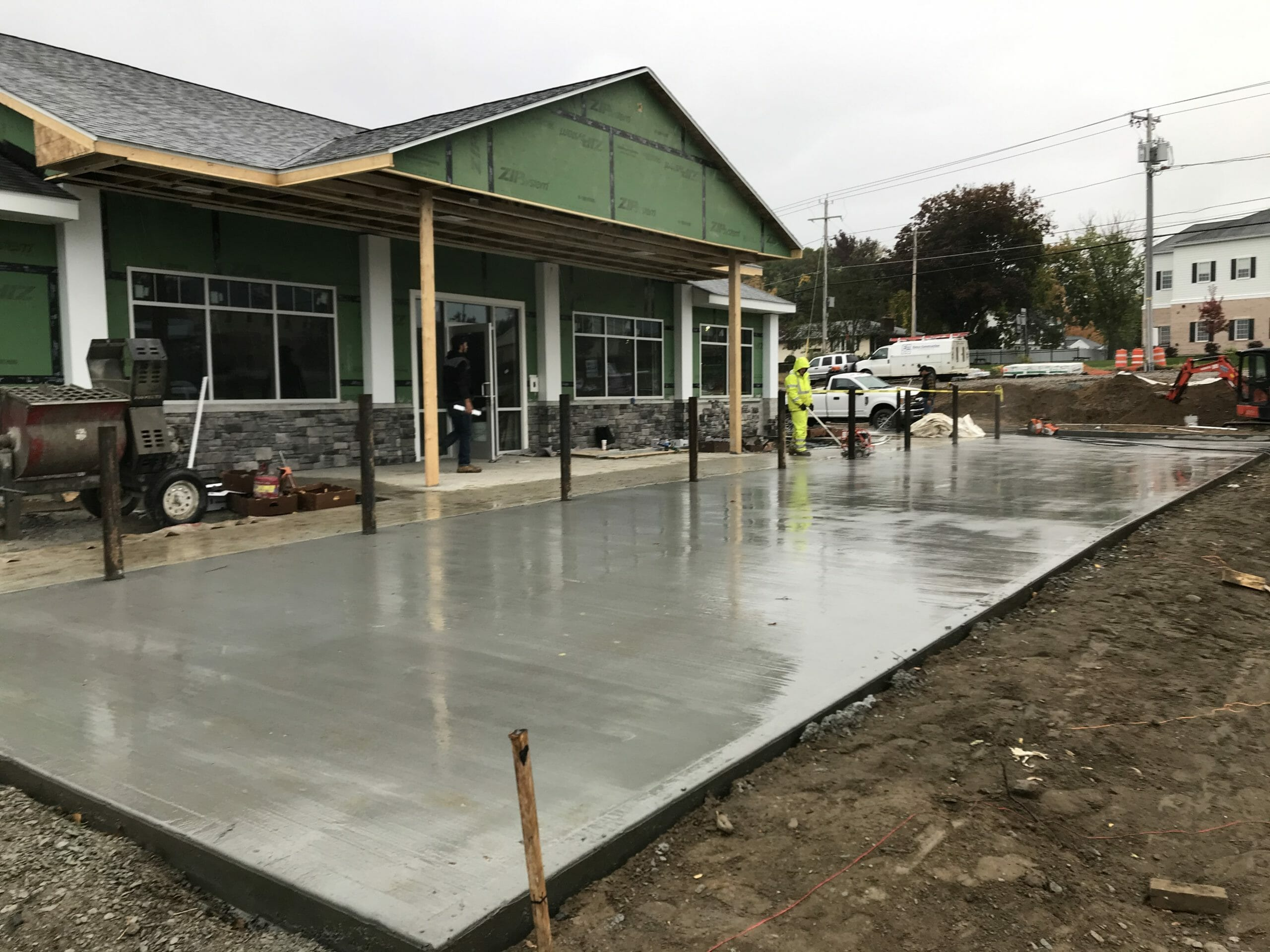 wet concrete in front of shop
