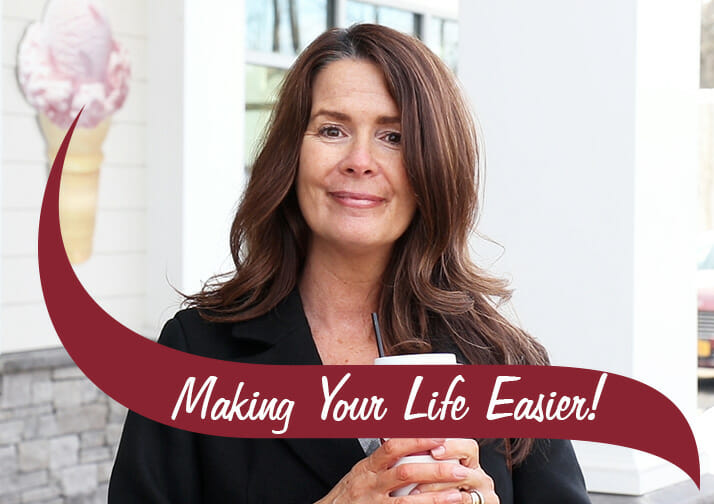 Making Your Life Easier. Mary in front of a shop holding a coffee
