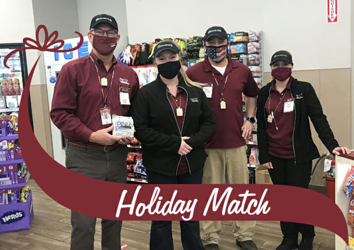 Holiday Match. Gary dake poses with employees